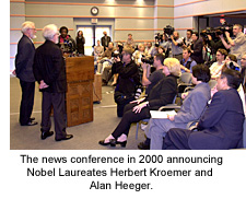 Chancellor Yang presents Nobel Laureates Alan Heeger and Herbert Kroemer to the press.